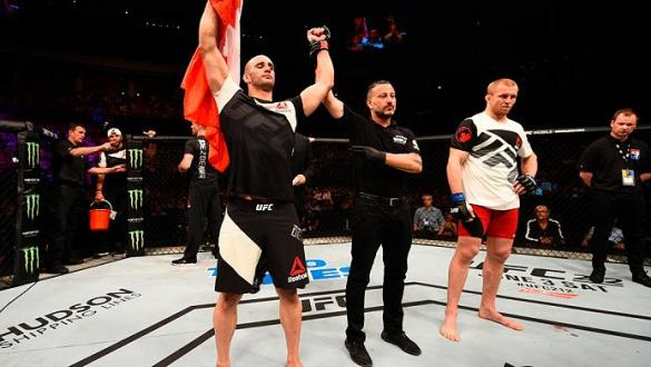 STOCKHOLM, SWEDEN - MAY 28:  (L-R) Volkan Oezdemir celebrates his knockout victory over Misha Cirkunov in their light heavyweight fight during the UFC Fight Night event at the Ericsson Globe Arena on May 28, 2017 in Stockholm, Sweden. (Photo by Jeff Botta