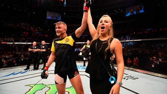 STOCKHOLM, SWEDEN - MAY 28:  Alexander Gustafsson proposes to his girlfriend Moa Antonia Johansson after his knockout victory over Glover Teixeira in their light heavyweight fight during the UFC Fight Night event at the Ericsson Globe Arena on May 28, 201