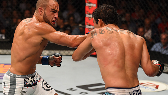 MEXICO CITY, MEXICO - JUNE 13:  (L-R) Eddie Alvarez of the United States punches Gilbert Melendez of the United States in their lightweight bout during the UFC 188 event at the Arena Ciudad de Mexico on June 13, 2015 in Mexico City, Mexico. (Photo by Josh