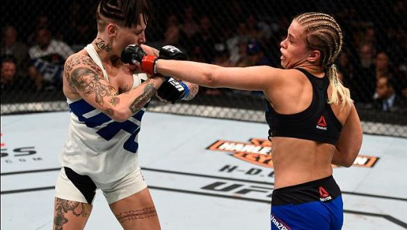 VANCOUVER, BC - AUGUST 27:  (R-L) Paige VanZant of the United States punches Bec Rawlings of Australia in their women's strawweight bout during the UFC Fight Night event at Rogers Arena on August 27, 2016 in Vancouver, British Columbia, Canada. (Photo by