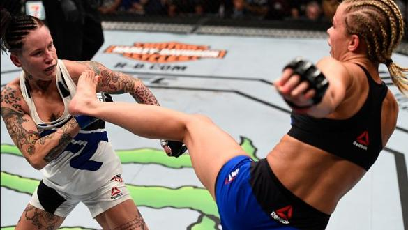 VANCOUVER, BC - AUGUST 27:  (R-L) Paige VanZant of the United States kicks Bec Rawlings of Australia in their women's strawweight bout during the UFC Fight Night event at Rogers Arena on August 27, 2016 in Vancouver, British Columbia, Canada. (Photo by Je