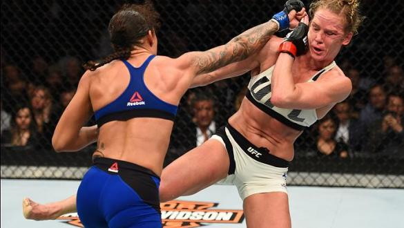 BROOKLYN, NEW YORK - FEBRUARY 11:  (L-R) Germaine de Randamie of The Netherlands punches Holly Holm in their women's featherweight championship bout during the UFC 208 event inside Barclays Center on February 11, 2017 in Brooklyn, New York. (Photo by Jeff