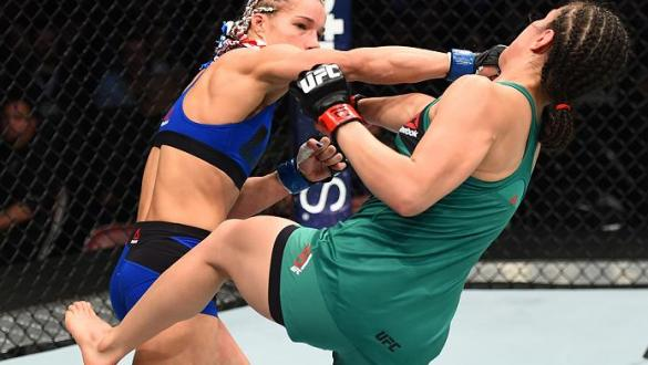 HOUSTON, TX - FEBRUARY 04:  (L-R) Felice Herrig punches Alexa Grasso of Mexico in their women's strawweight bout during the UFC Fight Night event at the Toyota Center on February 4, 2017 in Houston, Texas. (Photo by Jeff Bottari/Zuffa LLC/Zuffa LLC via Ge