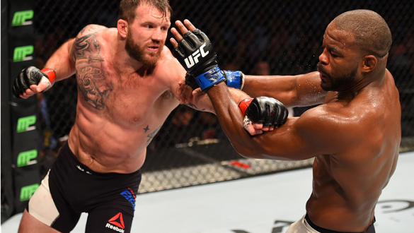 HOUSTON, TX - OCTOBER 03:  (L-R) Ryan Bader punches Rashad Evans in their light heavyweight bout during the UFC 192 event at the Toyota Center on October 3, 2015 in Houston, Texas. (Photo by Josh Hedges/Zuffa LLC/Zuffa LLC via Getty Images)