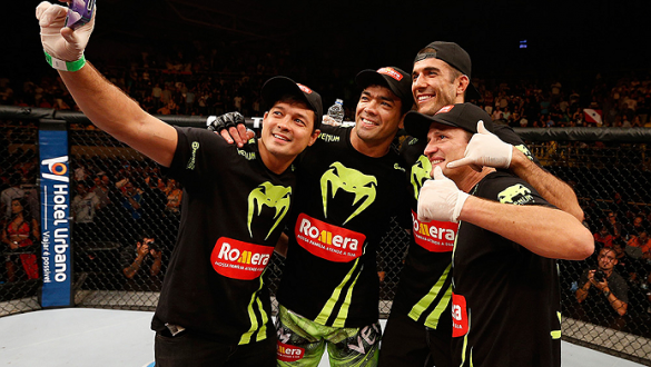 BARUERI, BRAZIL - DECEMBER 20:  Lyoto Machida (second left) of Brazil takes a photo in the Octagon with his team after his TKO victory over CB Dollaway in their middleweight fight during the UFC Fight Night event inside the Ginasio Jose Correa on December