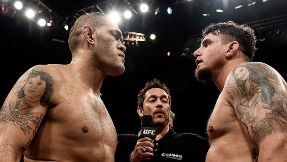 "PORTO ALEGRE, BRAZIL - FEBRUARY 22: Antonio ""Bigfoot"" Silva of Brazil and Frank Mir of the United States face off prior to their heavyweight bout during the UFC Fight Night at Gigantinho Gymnasium on February 22, 2015 in Porto Alegre, Brazil. (Photo by Bu"