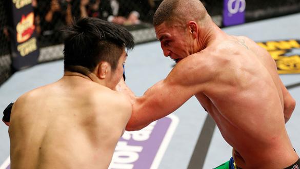 SAITAMA, JAPAN - MARCH 03:  (R-L) Diego Sanchez punches Takanori Gomi in their lightweight fight during the UFC on FUEL TV event at Saitama Super Arena on March 3, 2013 in Saitama, Japan.  (Photo by Josh Hedges/Zuffa LLC/Zuffa LLC via Getty Images)