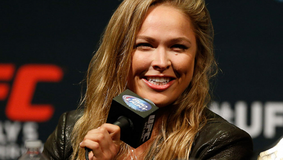 LAS VEGAS, NV - MAY 23:  UFC women's bantamweight champion Ronda Rousey interacts with media and fans during the UFC press conference at the MGM Grand Garden Arena on May 23, 2014 in Las Vegas, Nevada.  (Photo by Josh Hedges/Zuffa LLC/Zuffa LLC via Getty
