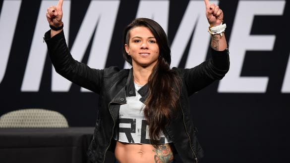 DALLAS, TX - MAY 12:  Claudia Gadelha of Brazil raises her hands during the UFC Summer Kickoff Press Conference at the American Airlines Center on May 12, 2017 in Dallas, Texas. (Photo by Josh Hedges/Zuffa LLC/Zuffa LLC via Getty Images)