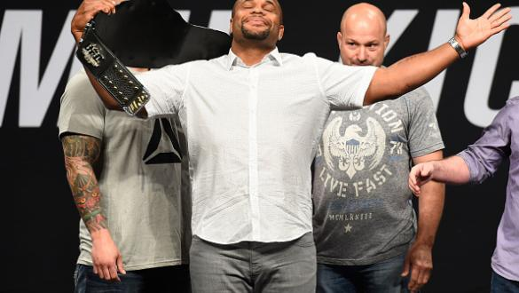 DALLAS, TX - MAY 12:  UFC light heavyweight champion Daniel Cormier raises his belt during the UFC Summer Kickoff Press Conference at the American Airlines Center on May 12, 2017 in Dallas, Texas. (Photo by Josh Hedges/Zuffa LLC/Zuffa LLC via Getty Images