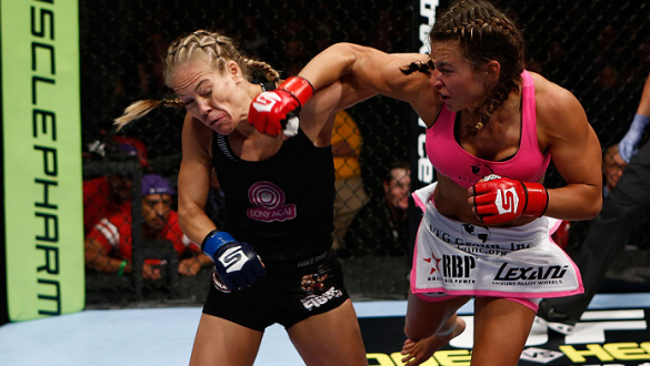 SAN DIEGO, CA - AUGUST 18:  (R-L) Miesha Tate punches Julie Kedzie during the Strikeforce event at Valley View Casino Center on August 18, 2012 in San Diego, California. (Photo by Esther Lin/Forza LLC/Forza LLC via Getty Images)