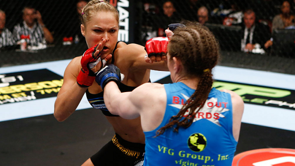 SAN DIEGO, CA - AUGUST 18:  (L-R) Ronda Rousey punches Sarah Kaufman during the Strikeforce event at Valley View Casino Center on August 18, 2012 in San Diego, California. (Photo by Esther Lin/Forza LLC/Forza LLC via Getty Images)
