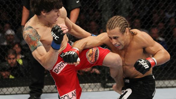SAN JOSE, CA - NOVEMBER 19: (R-L) Urijah Faber has his punch blocked by Brian Bowles knee during an UFC Bantamweight bout at the HP Pavillion on November 19, 2011 in San Jose, California.  (Photo by Josh Hedges/Zuffa LLC/Zuffa LLC via Getty Images)