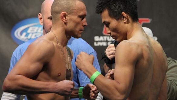 TORONTO, ON - DECEMBER 09:  (L-R) Featherweight opponents Mark Hominick and Chan Sung Jung face off after weighing in during the UFC 140 Official Weigh-in at the Air Canada Centre on December 9, 2011 in Toronto, Canada.  (Photo by Josh Hedges/Zuffa LLC/Zu