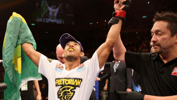 RIO DE JANEIRO, BRAZIL - JANUARY 14:  Jose Aldo (L) celebrates after defeating Chad Mendes in a featherweight bout during UFC 142 at HSBC Arena on January 14, 2012 in Rio de Janeiro, Brazil.  (Photo by Josh Hedges/Zuffa LLC/Zuffa LLC via Getty Images)