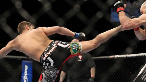 LAS VEGAS, NV - FEBRUARY 04:  Stephen Thompson (left) kicks Dan Stittgen during the UFC 143 event at Mandalay Bay Events Center on February 4, 2012 in Las Vegas, Nevada.  (Photo by Josh Hedges/Zuffa LLC/Zuffa LLC via Getty Images) *** Local Caption *** St