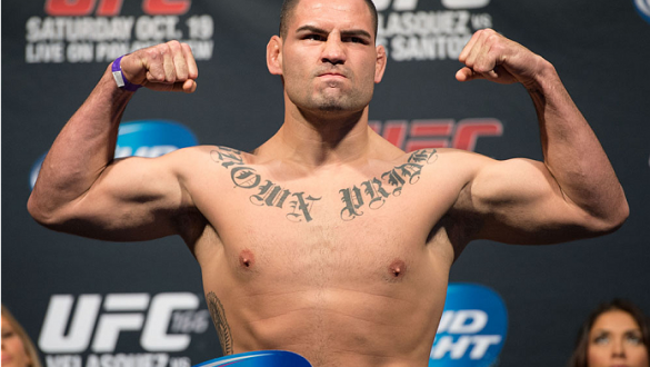 HOUSTON, TX - OCTOBER 18:  UFC heavyweight champion Cain Velasquez weighs in during the UFC 166 weigh-in at the Toyota Center on October 18, 2013 in Houston, Texas. (Photo by Jeff Bottari/Zuffa LLC/Zuffa LLC via Getty Images) *** Local Caption *** Cain Ve