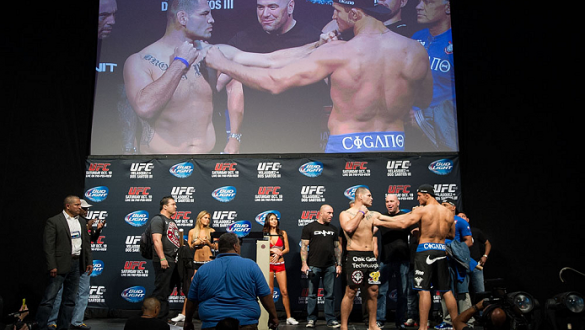 HOUSTON, TX - OCTOBER 18:  (L-R) UFC heavyweight champion Cain Velasquez and Junior Dos Santos face off during the UFC 166 weigh-in at the Toyota Center on October 18, 2013 in Houston, Texas. (Photo by Jeff Bottari/Zuffa LLC/Zuffa LLC via Getty Images) **