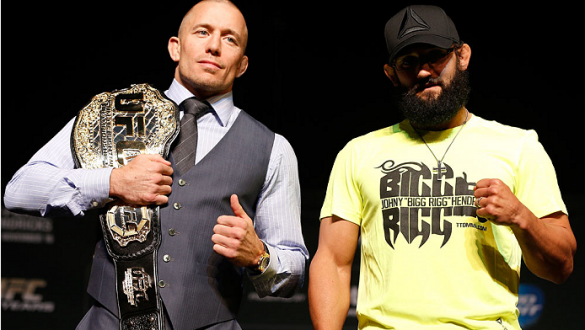 LAS VEGAS, NV - NOVEMBER 14: (L-R) Opponents Georges St-Pierre and Johny Hendricks pose for photos during the final UFC 167 pre-fight press conference inside the Hollywood Theatre at the MGM Grand Hotel/Casino on November 14, 2013 in Las Vegas, Nevada. (P
