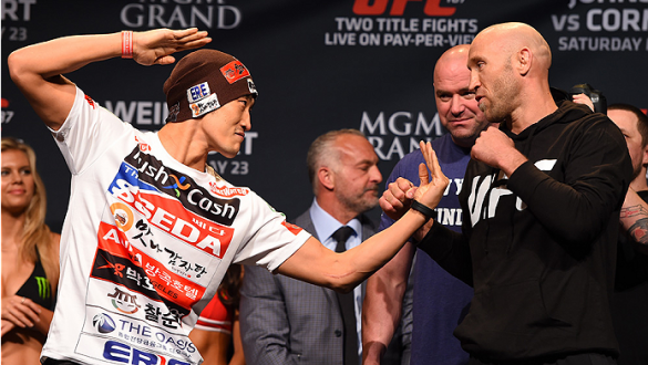 LAS VEGAS, NV - MAY 22:   (L-R) Opponents Dong Hyun Kim of South Korea and Josh Burkman face off during the UFC 187 weigh-in at the MGM Grand Conference Center on May 22, 2015 in Las Vegas, Nevada. (Photo by Josh Hedges/Zuffa LLC/Zuffa LLC via Getty Image