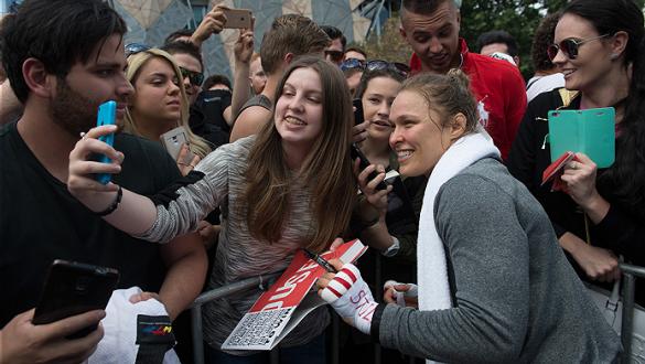 MELBOURNE, AUSTRALIA - NOVEMBER 12:  UFC women's bantamweight champion Ronda Rousey of the United States takes pictures with fans at Federation Square on November 12, 2015 in Melbourne, Australia. (Photo by Brandon Magnus/Zuffa LLC/Zuffa LLC via Getty Ima