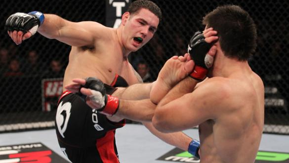 CHICAGO, IL - JANUARY 28:  (L-R) Chris Weidman kicks Demian Maia during the UFC on FOX event at United Center on January 28, 2012 in Chicago, Illinois.  (Photo by Nick Laham/Zuffa LLC/Zuffa LLC via Getty Images) *** Local Caption *** Chris Weidman; Demian