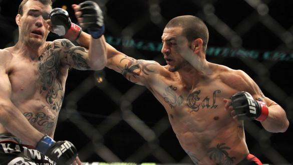 CHICAGO, IL - JANUARY 28:  (L-R) George Roop and Cub Swanson trade punches during the UFC on FOX event at United Center on January 28, 2012 in Chicago, Illinois.  (Photo by Josh Hedges/Zuffa LLC/Zuffa LLC via Getty Images) *** Local Caption *** Cub Swanso