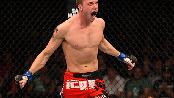 ADELAIDE, AUSTRALIA - MAY 10:   James Vick celebrates his submission victory over Jake Matthews in their lightweight bout during the UFC Fight Night event at the Adelaide Entertainment Centre on May 10, 2015 in Adelaide, Australia. (Photo by Josh Hedges/Z