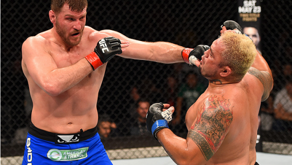 ADELAIDE, AUSTRALIA - MAY 10:   (L-R) Stipe Miocic punches Mark Hunt in their heavyweight bout during the UFC Fight Night event at the Adelaide Entertainment Centre on May 10, 2015 in Adelaide, Australia. (Photo by Josh Hedges/Zuffa LLC/Zuffa LLC via Gett