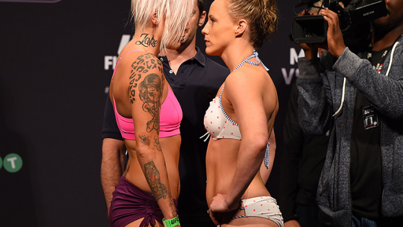 ADELAIDE, AUSTRALIA - MAY 09:   (L-R) Opponents Bec Rawlings of Australia and Lisa Ellis of the United States face off during the UFC weigh-in event at the Adelaide Entertainment Centre on May 9, 2015 in Adelaide, Australia. (Photo by Josh Hedges/Zuffa LL