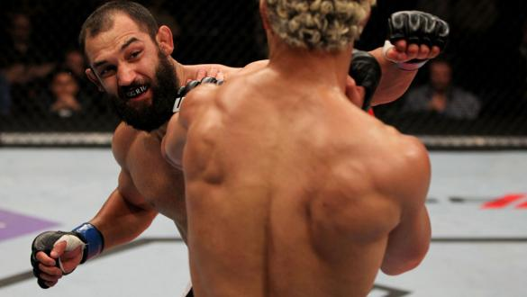 EAST RUTHERFORD, NJ - MAY 05:  Johny Hendricks (L) punches Josh Koscheck (R) during thier Welterweight bout at Izod Center on May 5, 2012 in East Rutherford, New Jersey.  (Photo by Josh Hedges/Zuffa LLC/Zuffa LLC via Getty Images)