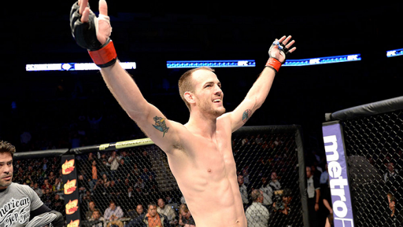 DULUTH, GA - JANUARY 15:  Cole Miller reacts after the win against Sam Sicilia in their featherweight fight during the UFC Fight Night event inside The Arena at Gwinnett Center on January 15, 2014 in Duluth, Georgia. (Photo by Jeff Bottari/Zuffa LLC/Zuffa
