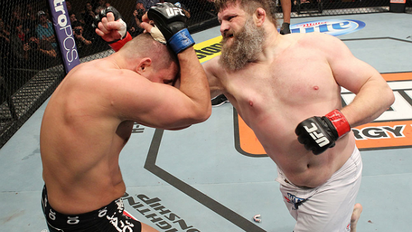LAS VEGAS, NV - DECEMBER 15:  (R-L) Roy Nelson punches Matt Mitrione during their heavyweight fight at the TUF 16 Finale on December 15, 2012  at the Joint at the Hard Rock in Las Vegas, Nevada.  (Photo by Jim Kemper/Zuffa LLC/Zuffa LLC via Getty Images)