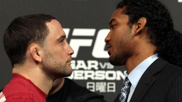 TOKYO, JAPAN - FEBRUARY 23:  (L-R) UFC Lightweight Champion Frankie Edgar and challenger Benson Henderson face off at the final UFC 144 pre-fight press conference at the Ritz-Carlton Hotel on February 23, 2012 in Tokyo, Japan.  (Photo by Josh Hedges/Zuffa