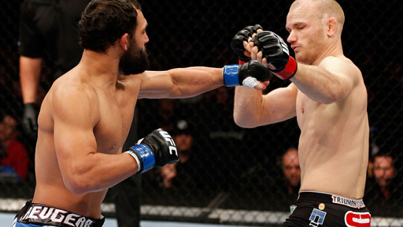 MONTREAL, QC - NOVEMBER 17:  Johny Hendricks (L) knocks out Martin Kampmann with a left hook in the first round to win their welterweight bout during UFC 154 on November 17, 2012  at the Bell Centre in Montreal, Canada.  (Photo by Josh Hedges/Zuffa LLC/Zu