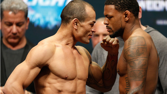 LAS VEGAS, NV - DECEMBER 27:  (L-R) Opponents Gleison Tibau and Michael Johnson face off during the UFC 168 weigh-in at the MGM Grand Garden Arena on December 27, 2013 in Las Vegas, Nevada. (Photo by Josh Hedges/Zuffa LLC/Zuffa LLC via Getty Images)