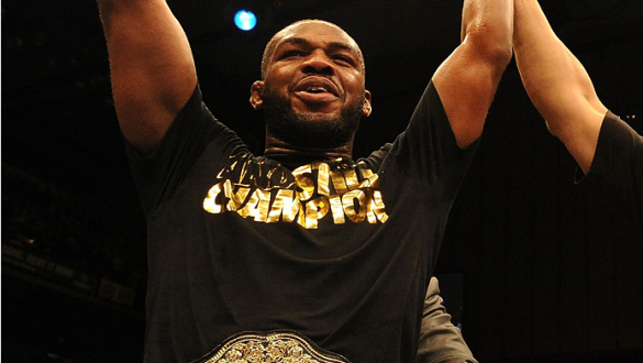 """BALTIMORE, MD - APRIL 26:  Jon """"Bones"""" Jones reacts after defeating Glover Teixeira in their light heavyweight championship bout during the UFC 172 event at the Baltimore Arena on April 26, 2014 in Baltimore, Maryland. (Photo by Patrick Smith/Zuffa LLC/Zu"""