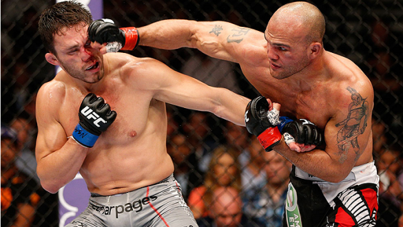 LAS VEGAS, NV - MAY 24:  (R-L) Robbie Lawler punches Jake Ellenberger in their welterweight bout during the UFC 173 event at the MGM Grand Garden Arena on May 24, 2014 in Las Vegas, Nevada. (Photo by Josh Hedges/Zuffa LLC/Zuffa LLC via Getty Images)