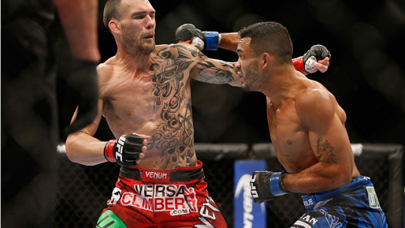 LAS VEGAS, NV - JULY 05:  (R-L) Rob Font punches George Roop in their bantamweight fight at UFC 175 inside the Mandalay Bay Events Center on July 5, 2014 in Las Vegas, Nevada.  (Photo by Josh Hedges/Zuffa LLC/Zuffa LLC via Getty Images)