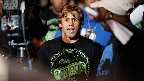LAS VEGAS, NV - JULY 05:  Urijah Faber enters the Octagon before his fight with Alex Caceres in their bantamweight fight at UFC 175 inside the Mandalay Bay Events Center on July 5, 2014 in Las Vegas, Nevada.  (Photo by Josh Hedges/Zuffa LLC/Zuffa LLC via