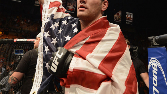 LAS VEGAS, NV - JULY 05:  UFC middleweight champion Chris Weidman celebrates defeating Lyoto Machida in their UFC middleweight championship fight at UFC 175 inside the Mandalay Bay Events Center on July 5, 2014 in Las Vegas, Nevada.  (Photo by Donald Mira