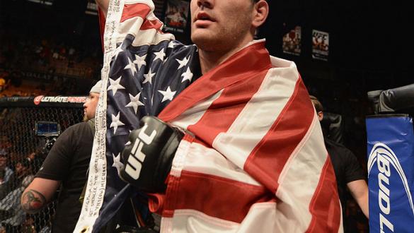 LAS VEGAS, NV - JULY 05:  UFC middleweight champion Chris Weidman celebrates defeating Lyoto Machida in their UFC middleweight championship fight at UFC 175 inside the Mandalay Bay Events Center on July 5, 2014 in Las Vegas, Nevada.  (Photo by Donald Mira