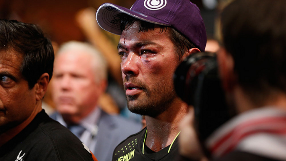 LAS VEGAS, NV - JULY 05:  Lyoto Machida leaves the Octagon after his loss to Chris Weidman in their UFC middleweight championship fight at UFC 175 inside the Mandalay Bay Events Center on July 5, 2014 in Las Vegas, Nevada.  (Photo by Josh Hedges/Zuffa LLC