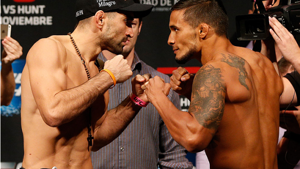 MEXICO CITY, MEXICO - NOVEMBER 14: (L-R) Opponents Ricardo Lamas of the United States and Dennis Bermudez of the United States face off during the UFC 180 weigh-in inside the Arena Ciudad de Mexcio on November 14, 2014 in Mexico City, Mexico. (Photo by Jo