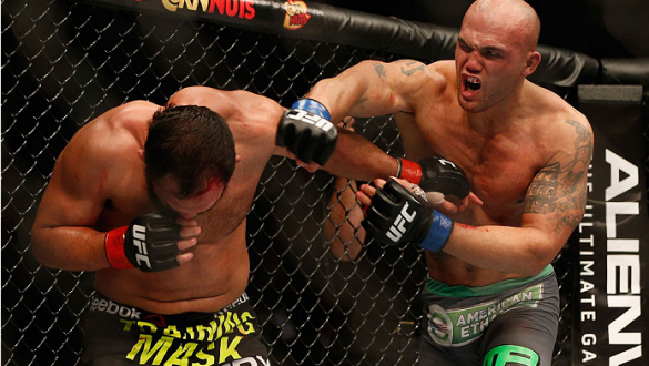 LAS VEGAS, NV - DECEMBER 06:  (R-L) Robbie Lawler punches Johny Hendricks in their UFC welterweight championship bout during the UFC 181 event inside the Mandalay Bay Events Center on December 6, 2014 in Las Vegas, Nevada.  (Photo by Josh Hedges/Zuffa LLC