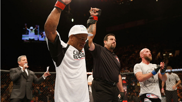 LAS VEGAS, NV - JANUARY 03:  (L-R) Hector Lombard celebrates his victory over Josh Burkman in their welterweight bout during the UFC 182 event on at the MGM Grand Garden Arena January 3, 2015 in Las Vegas, Nevada.  (Photo by Josh Hedges/Zuffa LLC/Zuffa LL