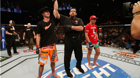 LAS VEGAS, NV - JANUARY 03:  (L-R) Donald Cerrone celebrates his victory over Myles Jury in their lightweight bout during the UFC 182 event on at the MGM Grand Garden Arena January 3, 2015 in Las Vegas, Nevada.  (Photo by Josh Hedges/Zuffa LLC/Zuffa LLC v