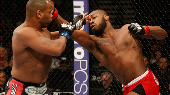 LAS VEGAS, NV - JANUARY 03:  (R-L) UFC light heavyweight championJon Jones punches Daniel Cormier in their UFC light heavyweight championship bout during the UFC 182 event at the MGM Grand Garden Arena on January 3, 2015 in Las Vegas, Nevada.  (Photo by J