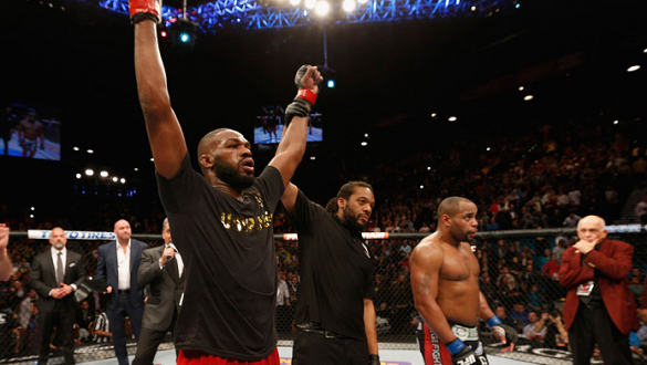 LAS VEGAS, NV - JANUARY 03:  UFC light heavyweight champion Jon Jones (L) celebrates his win over Daniel Cormier (R) in their UFC light heavyweight championship bout during the UFC 182 event at the MGM Grand Garden Arena on January 3, 2015 in Las Vegas, N