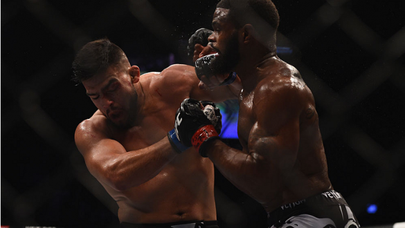 LAS VEGAS, NV - JANUARY 31:  (R-L) Tyron Woodley punches Kelvin Gastelum in their welterweight bout during the UFC 183 event at the MGM Grand Garden Arena on January 31, 2015 in Las Vegas, Nevada.  (Photo by Jeff Bottari/Zuffa LLC/Zuffa LLC via Getty Imag